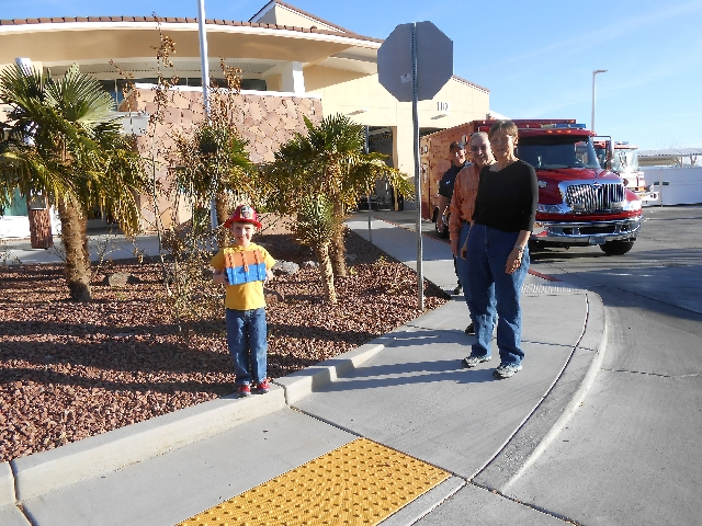 Lev Vernon, 6, leaves a pancake breakfast March 14 at Las Vegas Fire & Rescue Station No. 107 in Sun City Summerlin. He is followed by his grandparents, Bill and Vicki Belford, and firefighter Ron ...