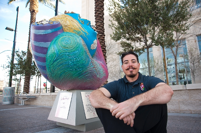 Laszlo Kristof painted a giant heart at Symphony Park across from The Smith Center. Kristof, a cancer survivor, is one of a dozen artists donating their talents for an auction set for 6 p.m. May 4 ...