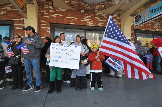 Jose and Virginia Osorio brought their three children, from left, Bridget, holding a sign, Brandon and Johan, holding an American flag, to a rally for immigration reform Feb. 24 in downtown Las Ve ...