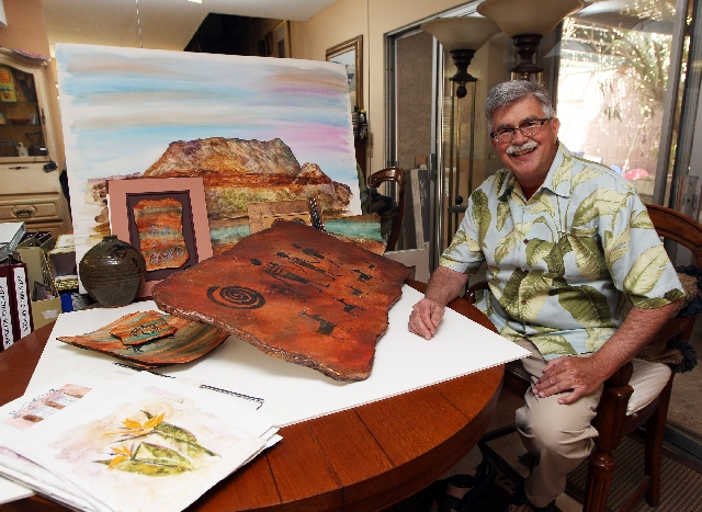 Mark Vranesh shows off some of his art at his Las Vegas home, March 21. Vranesh, who produced the ArtWalk at Trails Village Center, is transforming that event into a new one called Art at the Mark ...