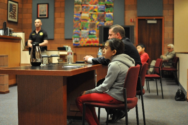 Fifth-grader Jazmin Rivera sits with Clark County district attorney Chris Hendricks March 19 at the North Las Vegas Justice Court, 2428 N. Martin Luther King Blvd. The mock trial was is part of th ...