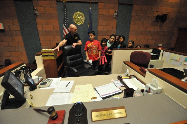Bailiff Ron Wright shows fifth-graders judge Natalie Tyrrell's courtroom desk March 19, 2013 at the North Las Vegas Justice Court, 2428 N. Martin Luther King Blvd. The mock trial was is part ...