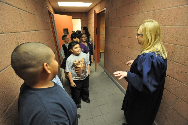 Judge Natalie Tyrrell shows students the holding cells March 19 at the North Las Vegas Justice Court, 2428 N. Martin Luther King Blvd., as part of the 12th annual Kids in the Court program.