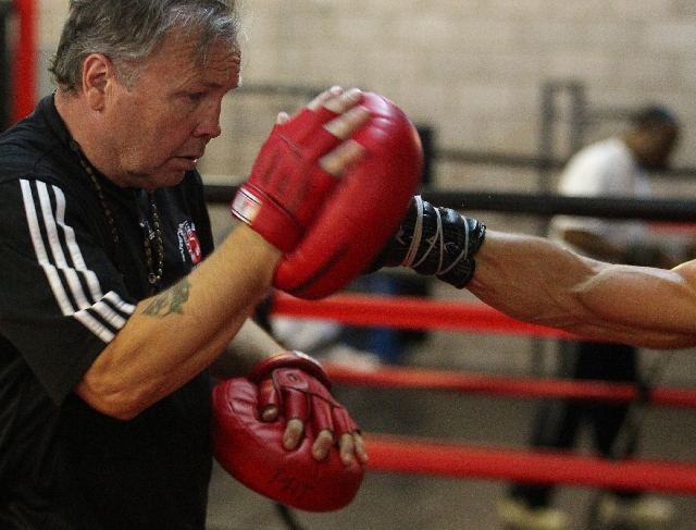 "Trainer and gym owner Pat Barry trains Diego Magdaleno last week at Barry's Boxing on South Highland Drive for his fight against WBO super featherweight champion Roman ""Rocky"" Ma ..."