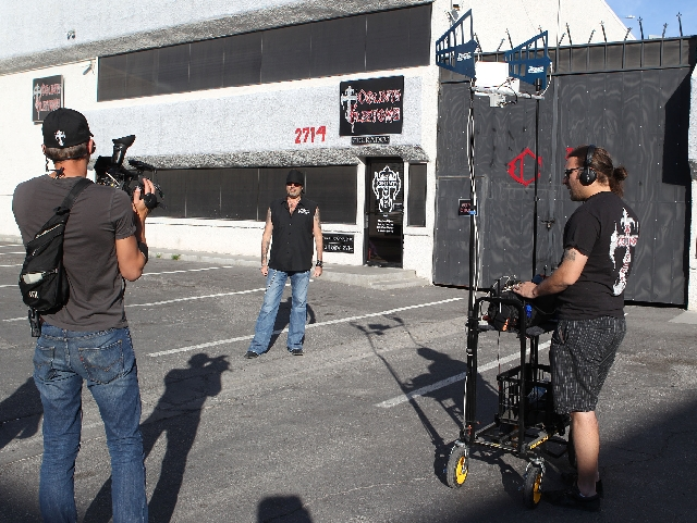 """Photography director Jeff Alberts, left, and sound engineer Radoslav Stefanov record Danny Koker on Wednesday at his shop in Las Vegas for History's """"Counting Cars."""" The show&rsq ..."""