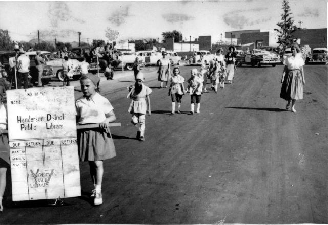 Children representing the Henderson District Public Library march in the 1955 Industrial Days Parade, a precursor to the Heritage Days Parade.