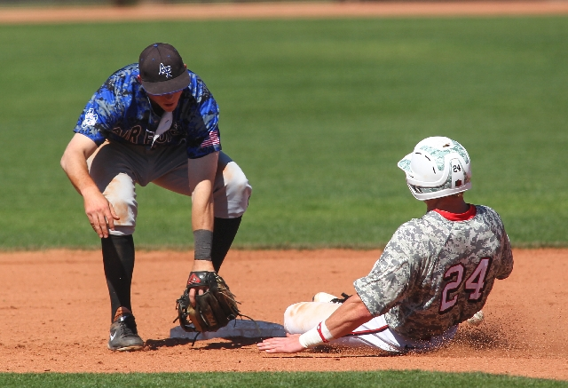 UNLV baserunner Brandon Bayardi slides into second base as Air Force second baseman Spencer Draws fails to tag him out during their third game at Wilson Stadium in Las Vegas on Sunday.