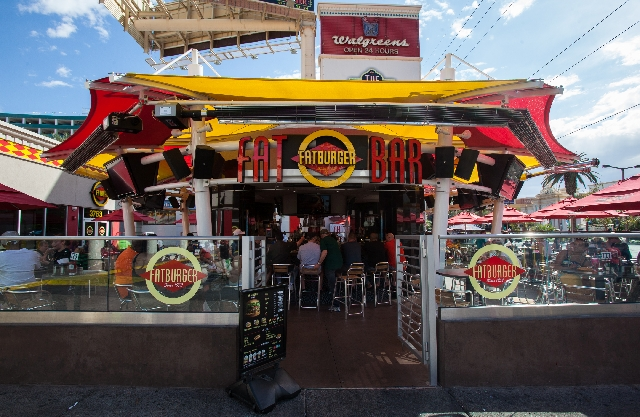 Wings are coming to Fatburger this summer. CEO Andy Wiederhorn plans to co-brand his new Buffalo's Cafe venture with the Fatburger brand until the former can take flight. Fat Bar, located ou ...