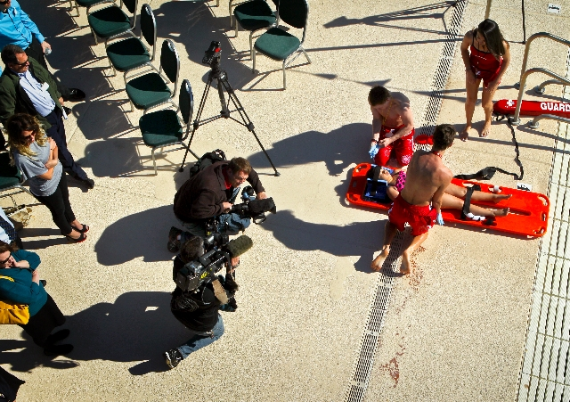 Video journalists document lifeguards at a mock drowning Monday attending to Leilani Olive at Silver Mesa Recreation Center in North Las Vegas. The Southern Nevada Child Drowning Prevention Coalit ...