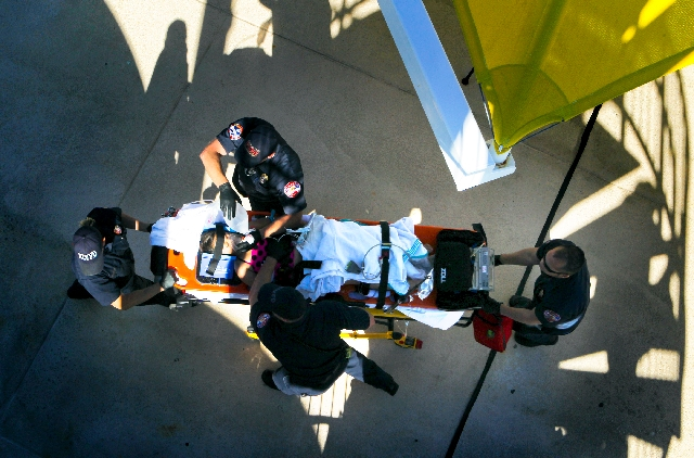 North Las Vegas FIre Department paramedics perform a mock drowning rescue on Leilani Olive Monday at Silver Mesa Recreation Center, 4025 Allen Lane. The Southern Nevada Child Drowning Prevention C ...