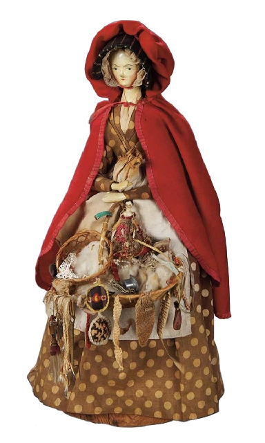 """This German doll is sometimes called a carved """"peg wooden"""" doll because of her jointed arms and legs. Her original clothing and peddler's tray attracted buyers at a Theriault&rsq ..."""