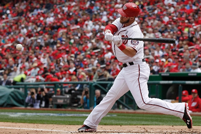 Washington Nationals left fielder Bryce Harper hits his second home run of the game in the fourth inning of the opening day baseball game against the Miami Marlins in Washington on Monday.