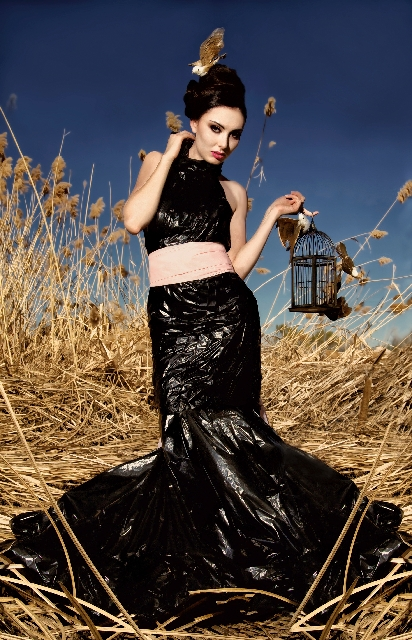 Damaged plastic bags and plastic ribbon are used to produce this two-piece black gown. (Photographer: The Shutter Eye by Kika Erives & Cristian Erives. Designer: Dayana Rueda. Model: Olivia Lakis. ...