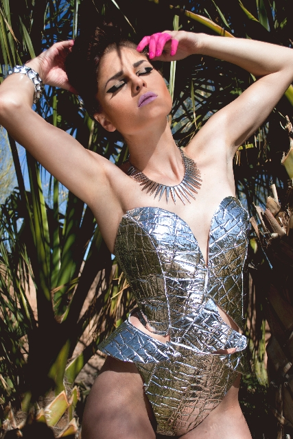 A corset with matching bikini bottoms is  made entirely of a windshield sun protector. (Photographer: Raen Badua. Designer: Reyna Herrera. Hair and makeup artist: Feralene Orpilla. Assistant: Dean ...