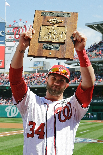 Bryce Harper displays his 2012 National League Rookie of the Year plaque before the game.