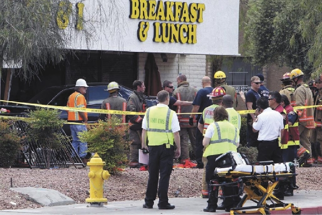 """Las Vegas police and firefighters  gather at the scene of the crash Monday at the Egg & I .  Brad Burdsall, who owns the restaurant, had no timetable on its reopening. """"Business will go on a ..."""