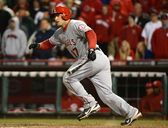 Angels catcher Chris Iannetta drives in two runs with a single off Reds reliever J.J. Hoover in the top of the 13th inning Monday at Cincinnati.