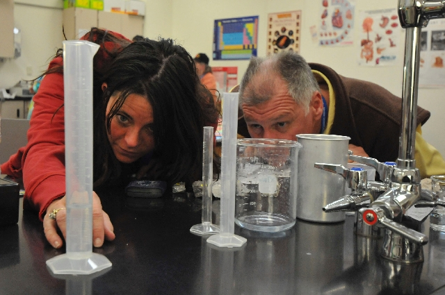Lisa Shah and George Radich measure the amount of water in a cylinder during a science experiment to find the density of different rocks March 26 at Faith Lutheran Middle School & High School. Mor ...