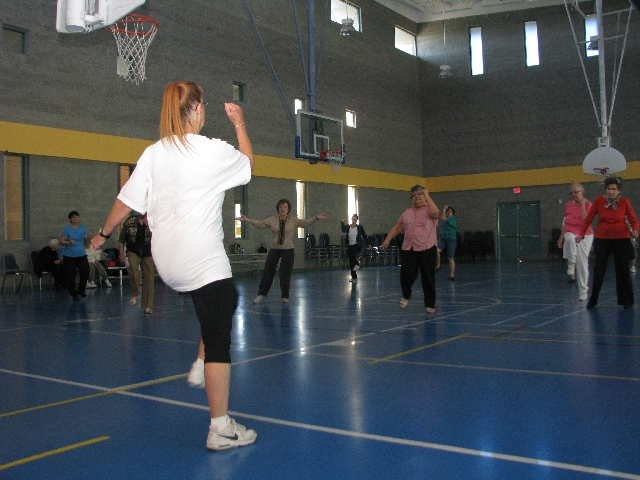 Seniors dance to pop music during a free fitness class at the Paradise Recreation Center.