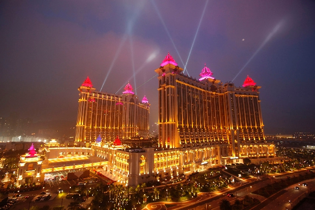 A casino complex in Macau is seen in 2011. The Chinese gaming enclave shattered the region's monthly gaming revenue record in March, with casinos collecting more than $3.92 billion from gamb ...