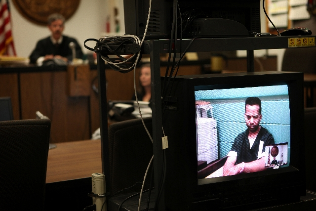 Former Nevada Assemblyman Steven Brooks is arraigned via videoconference in Judge John Gibson's courtroom in San Bernadino County Superior Court in Barstow, Calif., on Tuesday. Among Brooks& ...