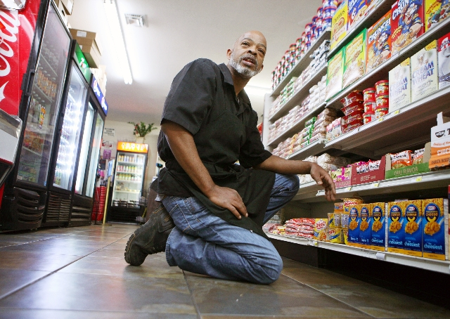 Carlos Batiste, owner of Jimmy's Louisiana Market Deli, organizes groceries April 2 in Las Vegas. Batiste hopes to open another business at McCarran International Airport.