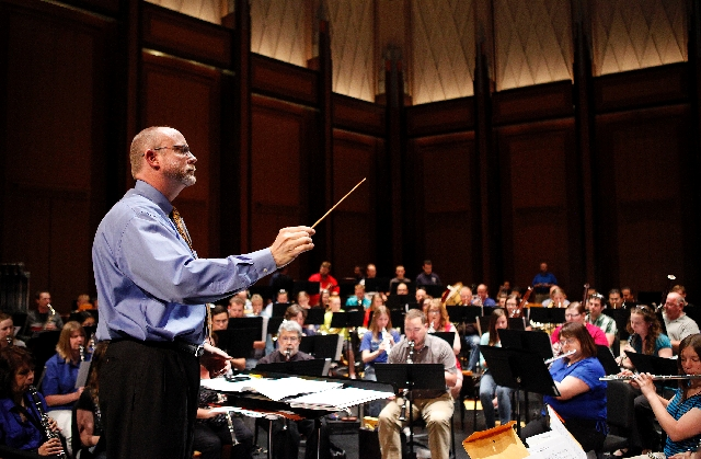 Rick McEnaney conducts a rehearsal.
