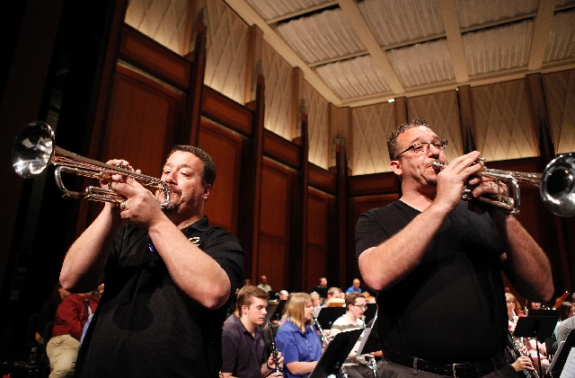 "Mitch Gabel, right, and Paul Beuning rehearse Tuesday for the ""Sousa 2.0"" concert at The Smith Center. The concert is a tribute to John Philip Sousa and will feature professionals and  ..."
