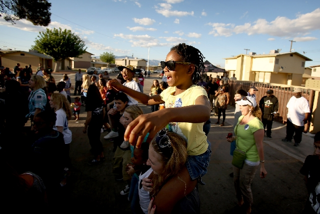 "Mahlaha Saumate, 6, and Brooke Turnstall dance during a community event Tuesday at the Sherman Gardens Annex . More than 100 people rallied to ""take back the community"" after a shootin ..."