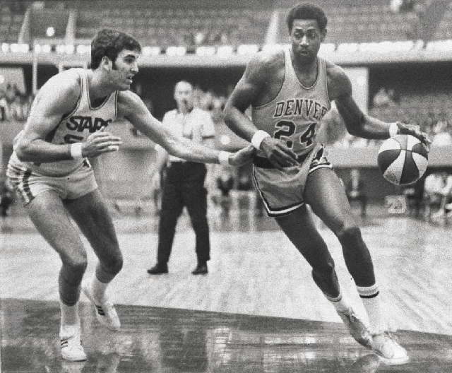 Spencer Haywood of the Denver Rockets, right, plays in an American Basketball Association game on May 5, 1970, in Anaheim, Calif. Haywood left the University of Detroit early to join the Rockets,  ...