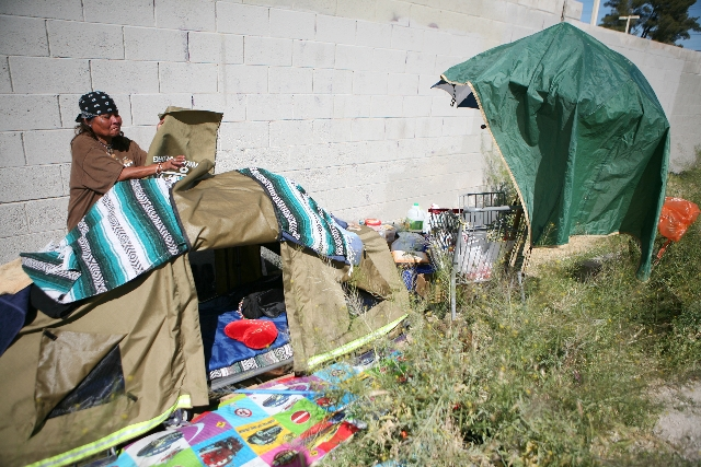 Erma Hernandez, 53, opens her Everyone Deserves A Roof shelter April 3 at her encampment on Bonanza Road. Hernandez received the shelter through Project Aqua and the nonprofit United Movement Orga ...