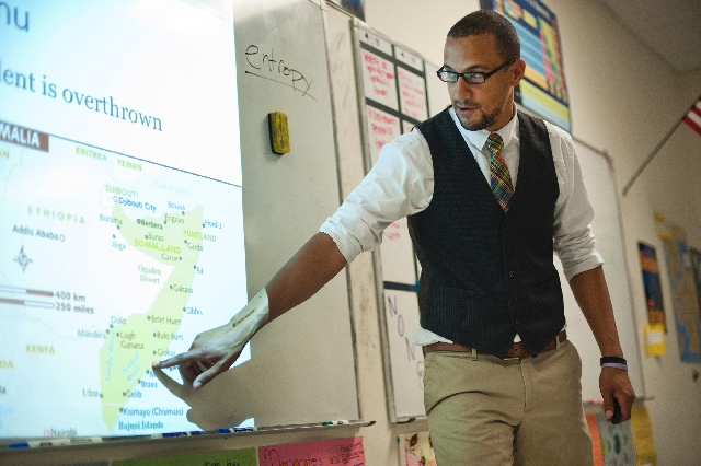 The Las Vegas Review-Journal's March Educator of the Month, teacher Blake Miles, explains a lesson in his military and world politics class at the Somerset Academy Charter School in North La ...