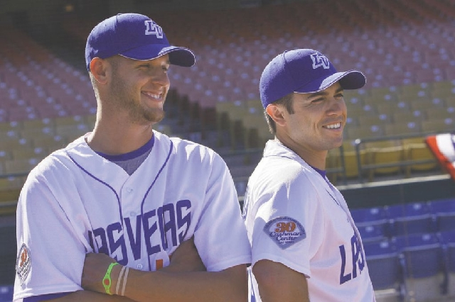Las Vegas 51s pitcher Zack Wheeler, left, and catcher Travis d'Arnaud hang out during media day at Cashman Field in Las Vegas on Tuesday. They are ranked as two of baseball's top eight ...