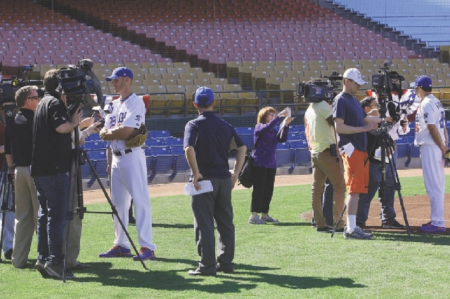 51s pitcher Zack Wheeler, left, and catcher Travis d'Arnaud, far right, are interviewed by the media on Tuesday. The two project to be playing in the major leagues by June, according to mana ...