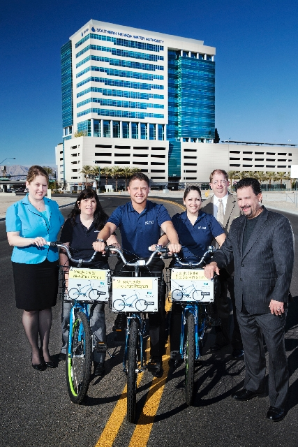 The Molasky Group management team poses with bikes in front of the Molasky Corporate Center. From left are Anna Juarez, general manager; Janna Nelson, accountant; Nick Reh, administrative assistan ...