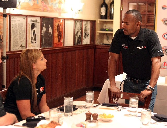 National Hot Rod Association drivers Antron Brown and Erica Enders-Stevens chat Thursday  at a media luncheon at the Palm restaurant in the Forum Shops at Caesars. Driver Tony Pedregon, who also a ...