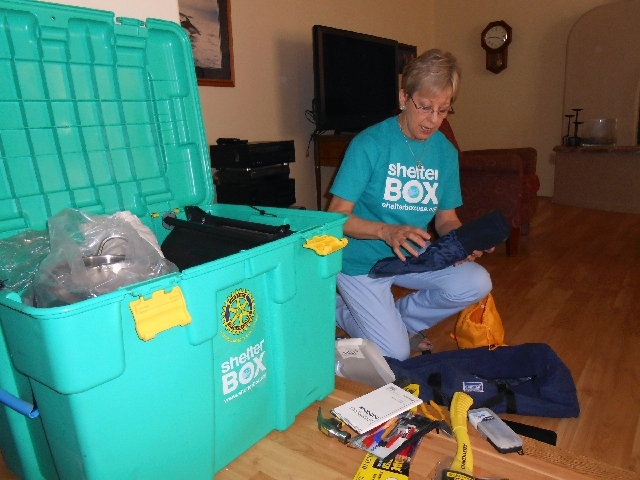 Presidential Volunteer Service Award winner Betty Mahalik, 59, unpacks a ShelterBox USA package March 29 at her home. The Centennial Hills resident has raised about $4,000 for the organization&rsq ...