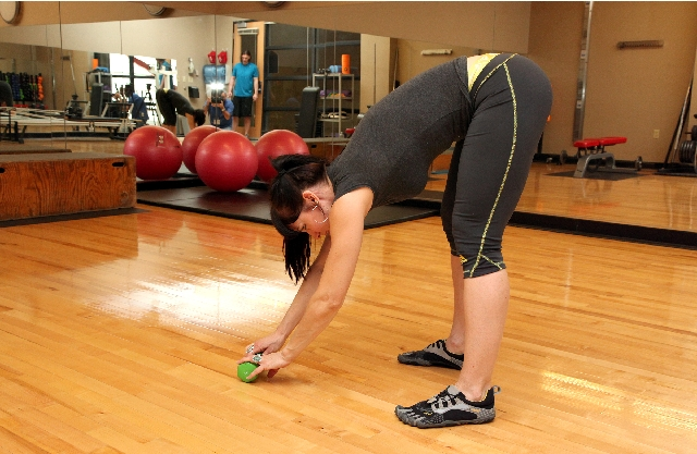 DEAD LIFT WHEN PICKING UP OBJECTS, ACTION: Keeping the back straight, hinge at the hips, then allow the knee to bend while keeping the shins vertical. Grasp the object and contract the glutes to s ...