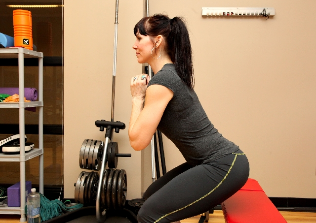 SQUAT WHILE SITTING, ACTION: Hinging at the hip, descend into a squat until reaching the chair. Contract the glutes and return to the starting position. Watch the knees, they should track in line  ...