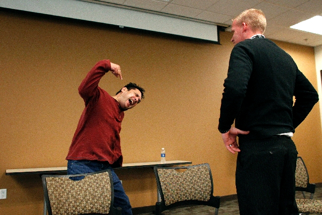 Corrections Sgt. John Storey, left, acts out excited delirium during crisis intervention training March 1 in Las Vegas.