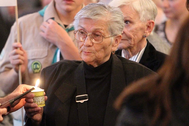 Holocaust survivor Stefania Feurwerker's candle is lit during the Las Vegas community Yom HaShoah Holocaust memorial observance at Temple Sinai in Summerlin in 2012.