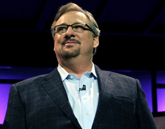 In this Nov. 29, 2010, file photo, Pastor Rick Warren acknowledges audience members during the Saddleback Civil Forum on Leadership and Service in Lake Forest, Calif. Saddleback Valley Community C ...