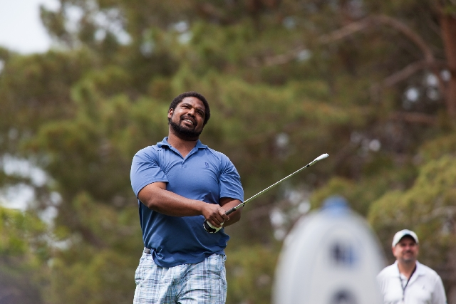 Eleven-time NFL Pro Bowl offensive tackle Jonathan Ogden watches a shot during the Michael Jordan Celebrity Invitational at Shadow Creek Golf Course on Saturday. Ogden, who lives in Las Vegas, wil ...