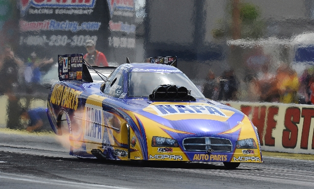 Funny Car driver Ron Capps lays down a run of 4.133 seconds at 302.55 mph Saturday during the third qualifying session for the SummitRacing.com Nationals at The Strip at Las Vegas Motor Speedway.