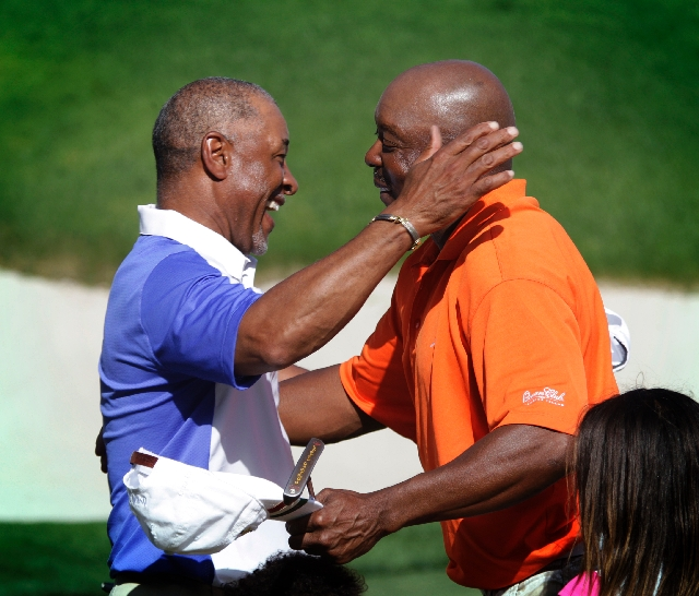 Ozzie Smith, left, and Vince Coleman hug after winning the Michael Jordan Celebrity Invitational on Sunday at Shadow Creek Golf Course. They won by four strokes over Wayne Gretzky and Ahmad Rashad.