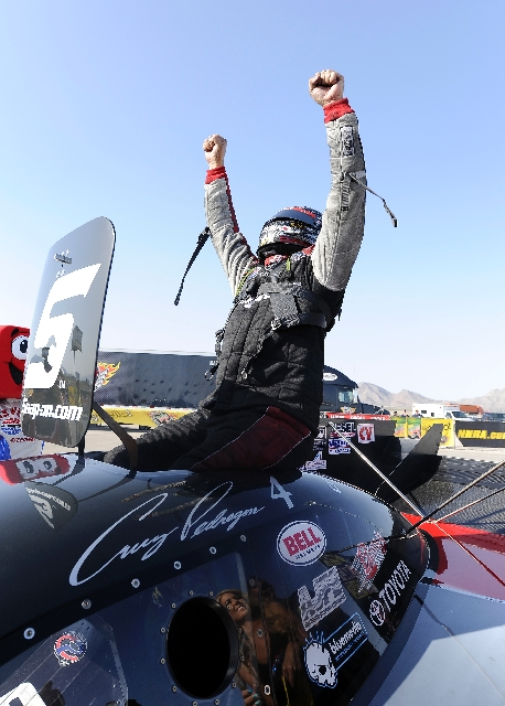 NHRA driver Cruz Pedregon rejoices atop his Funny Car dragster after defeating Courtney Force in the final to win the SummitRacing.com NHRA Nationals on Sunday at The Strip at Las Vegas Motor Spee ...
