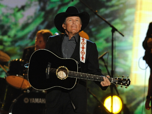 Singer George Strait performs Sunday at the 48th annual Academy of Country Music Awards at the MGM Grand Garden.