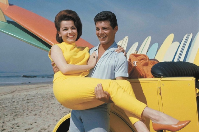 "In this 1963 file photo, actress Annette Funicello and singer Frankie Avalon are seen on Malibu Beach during the filming of ""Beach Party."" The former Mouseketeer Funicello, also known  ..."