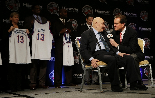 Former UNLV coach Jerry Tarkanian, left, talks with CBS announcer Jim Nantz during the Naismith Memorial Basketball Hall of Fame class announcement Monday in Atlanta.