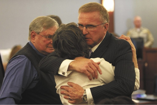 Plaintiff Bonnie Brunson embraces her lawyer Robert Eglet as her husband Carl Brunson, left, looks on after receiving a favorable verdict at the Clark County Regional Justice Center in Las Vegas o ...